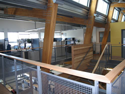 A look at the interior of the Gulf Island National Park Reserve's LEED building's second story, showing the staircase and several cubicles.