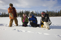 Photo of four volunteers and staff in Kluane National Park and Reserve in the winter