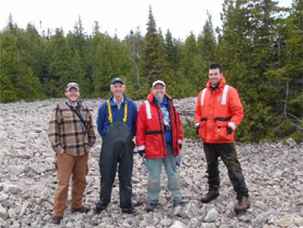 Parks Canada archaeologists on a 'Pukaskwa Pit' rich beach.