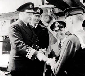 Rear Admiral L.W. Murray addressing officers and ratings of HMCS St. Croix, which sank the German submarine U-90 on July 24, 1942 while escorting convoy ON113.