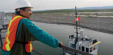 Aklavik's Andrew Gordon Jr. looks out across the Stokes Point cleanup worksite from the bridge of the John Wurmlinger