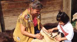 Métis Interpreter Bev Weber explaining traditional Métis art to Jaylyn Anderson (4 yrs old). Rocky Mountain House National Historic Site of Canada