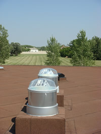 A close up of two solar lights on the roof of the Lower Fort Garry National Historic Site Museum building.