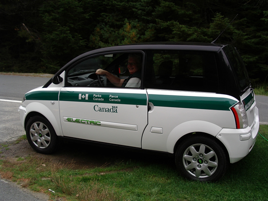 A Parks Canada employee driving one of our electric vehicles in Kejimkujik National Park.