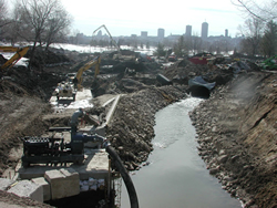 A look at the extensive construction site of Cartier-Brébeuf park in the winter, with the city in the background.
