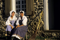 Photo of two volunteers in period costume at Fortress of Louisbourg National Historic Site