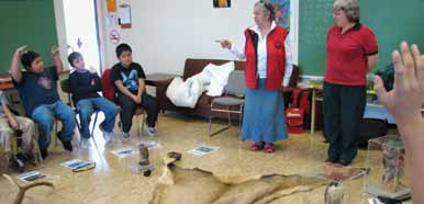 Hul'q'umi'num' Elder Philomena Pagaduan and Parks Canada Interpreter Athena George share stories in the schools about threatened plants and animals