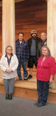 Members of the Nuu-chah-nulth Working Group on the steps of the new Longhouse Exhibit