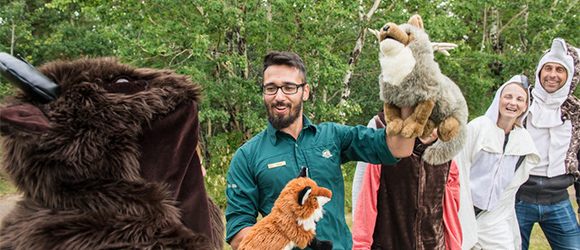 Parks Canada employee participating in an animal puppet show.