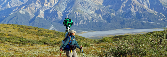A Parks Canada team member carrying the Google Trekker