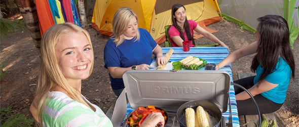 Women prepare food in camping at South Kouchibouguac campground.
