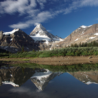 Mount Assiniboine in background with river and bank in foreground.