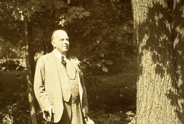 Photo of William Lyon Mackenzie King walking in woods