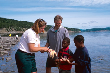 Interpreter with children on beach