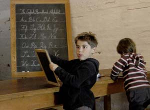 Two boys doing lessons on the blackboard, Halifax Citadel NHS