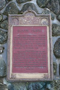 Plaque text