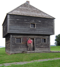 Man standing in front of blockhouse door