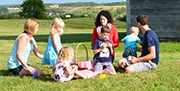 Family enjoying a picnic on the grounds at Fort Edward.