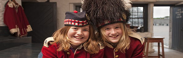 Two little girls dressed as Highlanders at the Halifax Citadel National Historic Site.