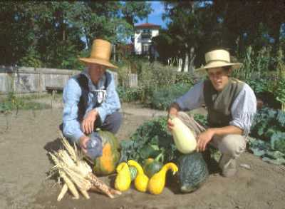 Gardeners pose with a variety of vegetables grown in the Bellevue House gardens.