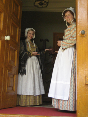 Staff in period costume welcome you in to the house