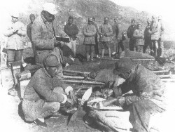 Bethune teaching while operating on injured Chinese in the field, circa 1939.