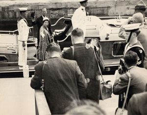 Prince Philip and Queen Elizabeth smiling for photographers at the Sault Canal