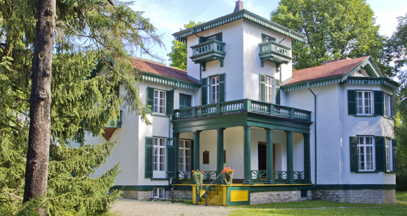 Historic Bellevue House stands agains the lush green gardens
