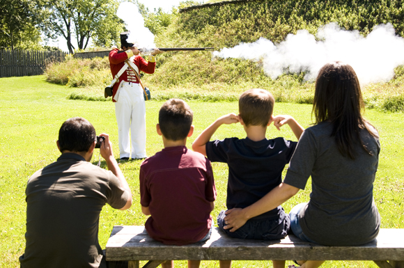 A family watching a re-enactment
