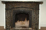 Mantel with a fake marble finish,