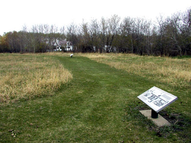 View of one of the pathways and plaque texts at Fort Pelly NHS