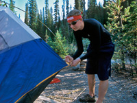 A Parks Canada visitor setting up a tent
