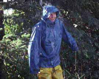 Man in rain gear in the rain.