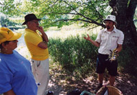 A park interpreter talks about Blanding's turtles using a model