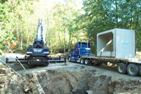 Large crane and truck for culvert excavation