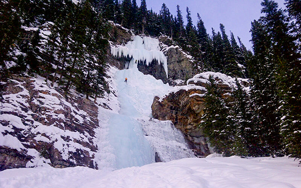 Ice climbers on Louise Falls at the back of Lake Louise.