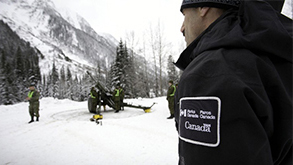 Parks Canada Avalanche Officer, Jeff Goodrich overlooks the Howitzer operation. Photo: Rob Buchanan
