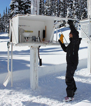 Parks Canada staff opening the Stevenson screen weather station.