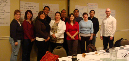 Huu-ay-aht First Nations and Parks Canada Cooperative members at a meeting