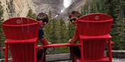 Two members of trail crew enjoy a brief moment in the Red Chairs