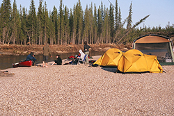 A group of canoeists camp along the Owl River in Wapusk National Park