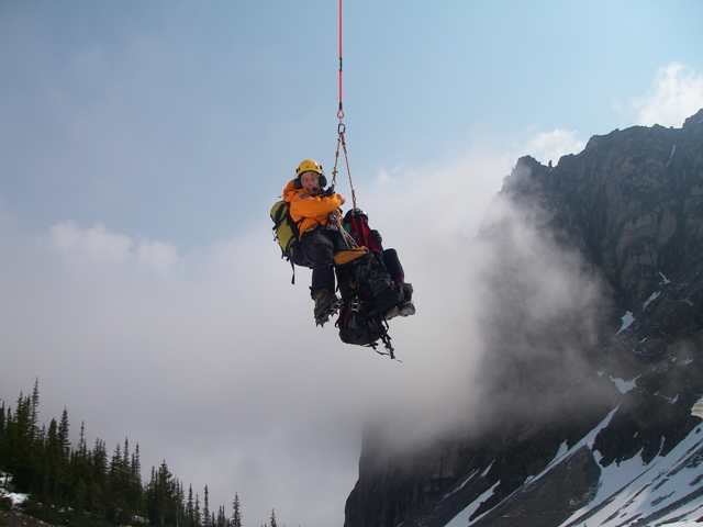 Parks Canada Visitor Safety Specialist heli -slinging with the second overdue climber.