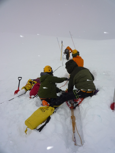 Parks Canada Rescue Team prepares to lower a member into the crevasse