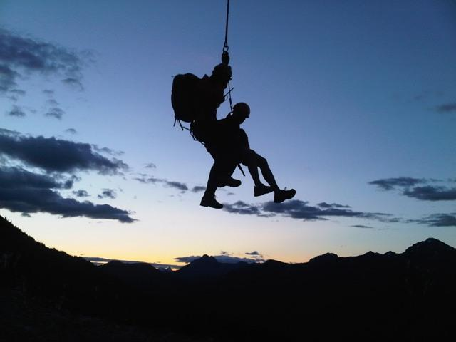 Parks Canada Visitor Safety Specialists heli-slinging as darkness falls.