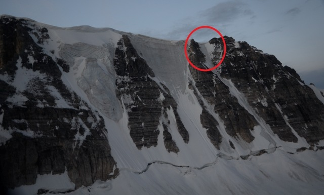 The north face of Mt. Fay.  The red circle shows the approximate location of the rockfall accident on the Roth- Kallen route.  Note the large cornices still overhanging all routes on this north face.