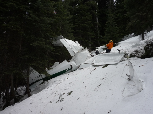 A Parks Canada Visitor Safety Specialist at work on the site of the airplane crash