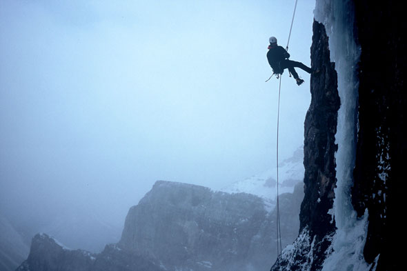 A mixed climber swings for the ice in Yoho National Park