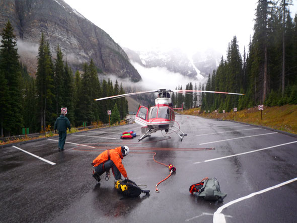 A Parks Canada Mountain Safety Specialist prepares for a helicopter rescue
