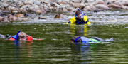 Snorklers in the Upper Salmon River at Black Hole, swimming with salmon