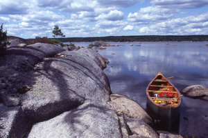 canoe and rocky landscape